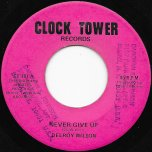 Never Give Up / Ver - Delroy Wilson
